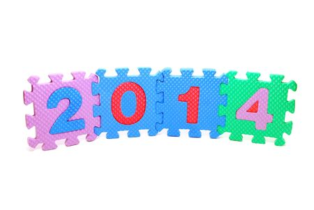 Text 2014 Made of Children Puzzle Parts Isolated on White Standard-Bild