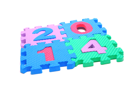 Text 2014 Made of Children Puzzle Parts Isolated on White Stock Photo