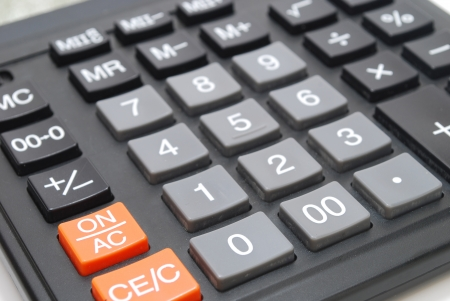 Closeup of Black Calculator Keypad with Grey Buttons Stock Photo