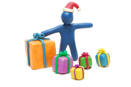 Plasticine Santa Claus with Heap of Various Gift Boxes Isolated on White Stock Photo