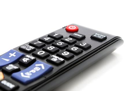 Black TV Remote Control Closeup Isolated on White Stock Photo