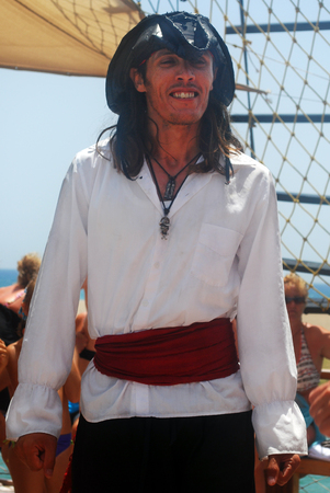 Man Wearing Pirate Costume with Ship Background