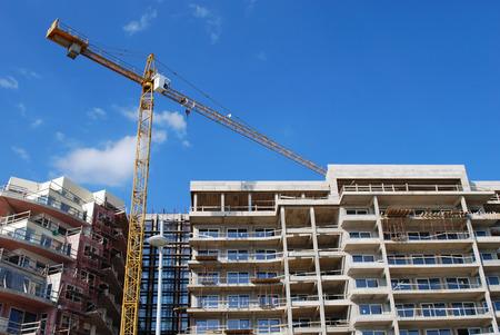 public housing: Construction Crane Building New Modern House Concept Stock Photo