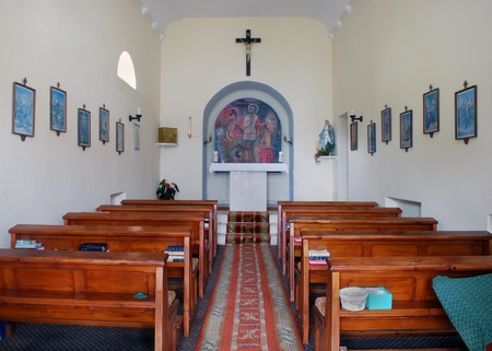 Tranquil Scene of Catholic Chapel (Church) Interior