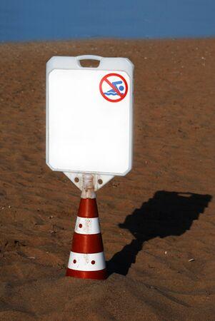Blank Billboard No Swimming Sign Standing on Sand Beach Stock Photo