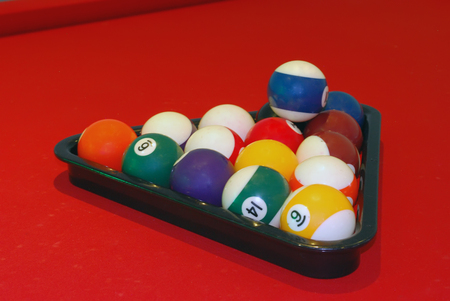 Billiard Balls in Triangle on the Red Table Stock Photo
