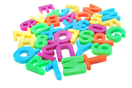 Heap of Colored English Alphabet Letters and Digits Isolated on White Stock Photo