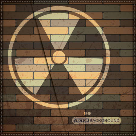 warning against a white background: Background with radiation symbol on brick wall