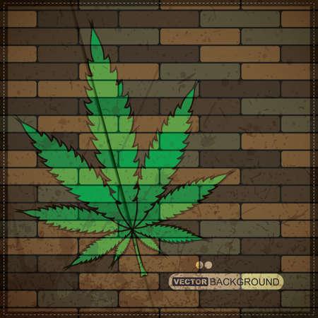 Grunge achtergrond met cannabis blad op bakstenen muur