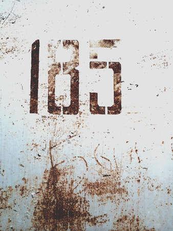 grunge: Number 185 on metallic grunge wall Stock Photo