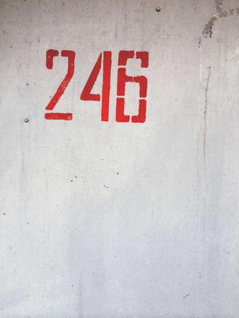 grunge: Number 246 on metallic grunge wall