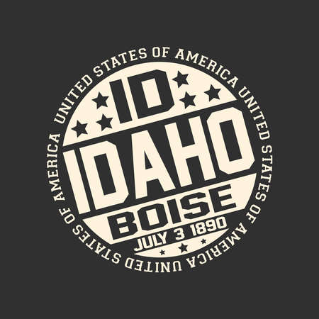 Decorative stamp on black background with postal abbreviation ID, state name Idaho, capital Boise and date become a state July 3, 1890 with text United States of America around it.