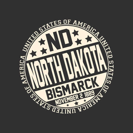 Decorative stamp on black background with postal abbreviation ND, state name North Dakota, capital Bismarck and date become a state November 2, 1889 with text United States of America around it.