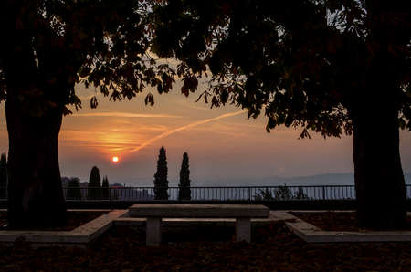 sensations: The spectacle of a sunset seen from a bench