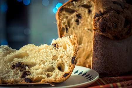 Panettone. Traditional italian dessert for christmas with chistimas light on background Stock Photo