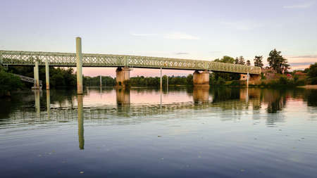 Green metallic bridge over the Saone river