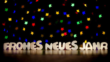 frohes neues jahr happy new year in german language text beautiful multicolor bokeh