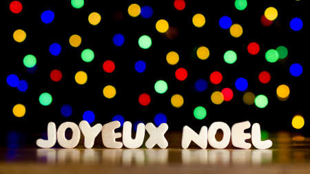 joyeux noel merry christmas in french language text beautiful multicolor bokeh background with