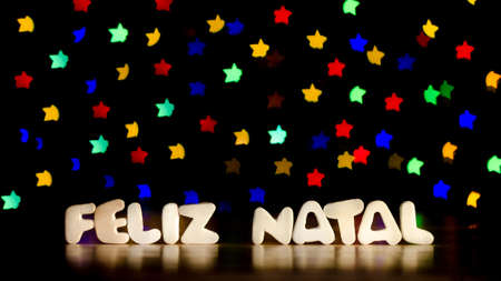 Feliz natal, merry christmas in Portuguese language, text, beautiful multicolor bokeh background with copy space