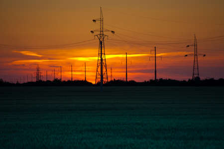 electricity infrastucture seen at sunset photo