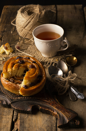 Tea with cinnamon Buns and raisin