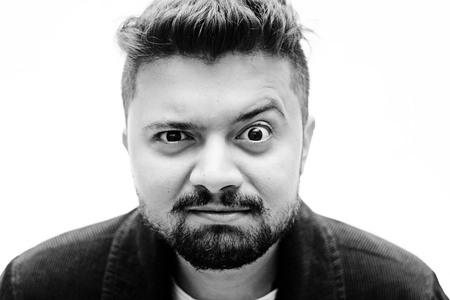 baffled: Close-Up Studio Black and white Portrait Man Baffled Facial Expression isolated on white background Stock Photo