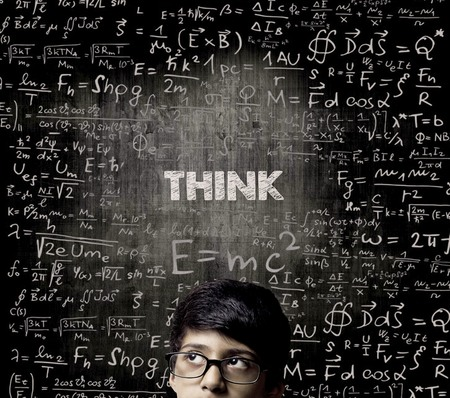 Cute Intelligent Little Boy Looking Up Thinking andWearing Glasses Standing Before A Chalkboard, Chemical Formulas Are Written On Board With The Chalkboard Typography Of The Word THINK Imagens