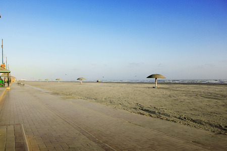 perfect waves: Empty and clean beach of Clifton, Karachi Pakistan during sunset