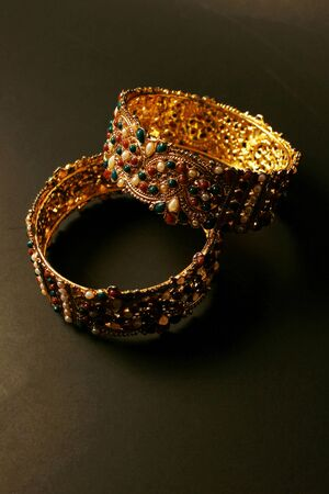 bangle: Bangle. Colorful traditional jewelry from India and Pakistan on black background