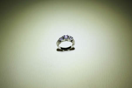 spot light: Wedding ring with diamond. Sign of love. Fashion jewelry in spot light