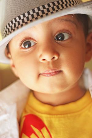 fedora: Portrait of a cute south asian boy wearing a shirt and fedora hat. Studio shot Stock Photo