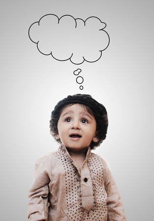 thinking cloud: Adorable Intelligent Little Boy Thinking Cloud While Standing Before A White Background; Thinking Process With Chalk Board
