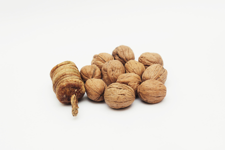 khan: Dry figs and Walnuts isolated on white background