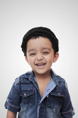 Portrait. happy little south asian boy wearing cultural hat. smiling and looking in the camera isolated on white Stock Photo - 70098661