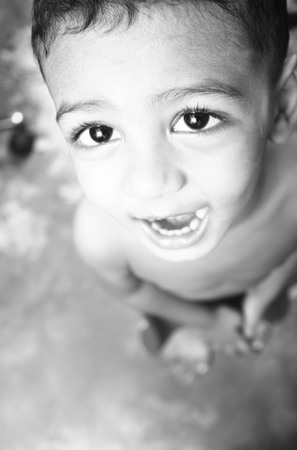 Little south asian boy portrait laughing and looking into the camera