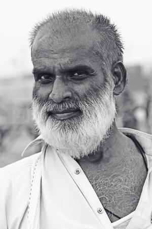Portrait - Old man at Clifton beach, Karachi, Pakistan 26062012