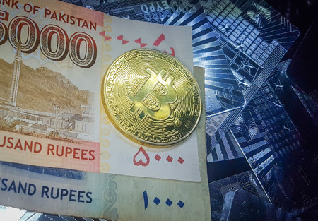 Golden BitCoin On The Five Thousand And One Thousand Pakistani Rupees Note