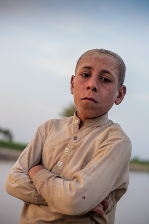 Portrait Of A Village Boy, Standing And Looking At Camera In Sindh, Moro, Pakistan 26/08/2017 Foto de archivo - 121483095