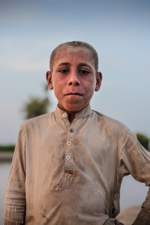 Portrait Of A Village Boy, Standing And Looking At Camera In Sindh, Moro, Pakistan 26/08/2017 Foto de archivo - 121483096