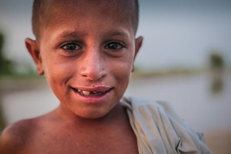 Portrait Of A Village Boy, Smiling And Looking At Camera In Sindh, Moro, Pakistan 26/08/2017 Foto de archivo - 121483099