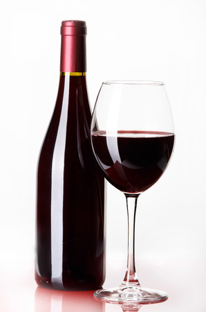 Red wine bottle and glass isolated on white background Stock Photo