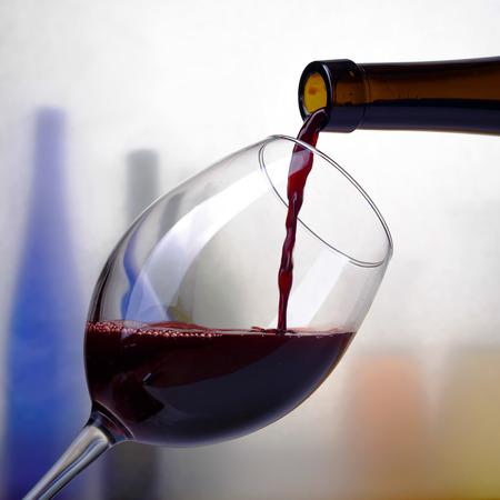red wine poured into a glass Banco de Imagens