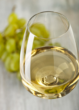 Wine. Grapes. Glass with white wine Stock Photo