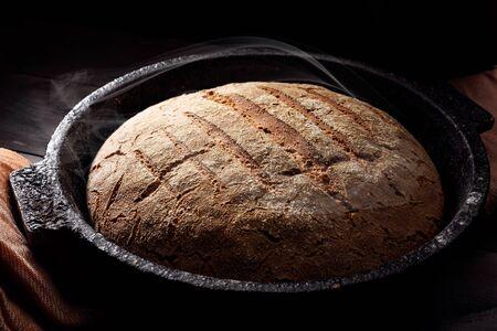 Fresh homemade crisp bread. French bread. Bread at leaven. Unleavened bread. Dark background.