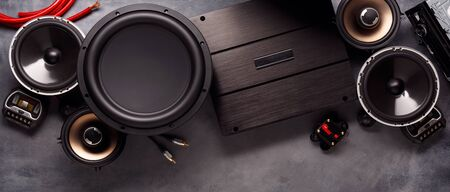 car audio, car speakers, subwoofer and accessories for tuning. Dark background. Top view. Banco de Imagens