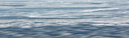 The abstract background of ice structure on the river. Panoramic image. Banner Banco de Imagens