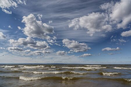 Sea with waves and clouds. Strong wind. The natural element. Banco de Imagens