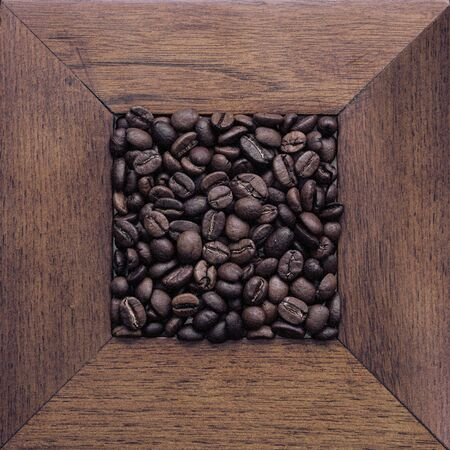Coffee beans on the table. Top view. Dark background.