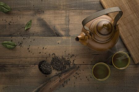 Tea concept. Teapot with tea on table. View from above with copy space. Asian tea bowl and teapot. Archivio Fotografico