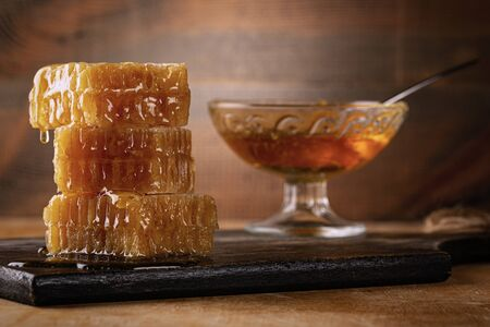 Honey background. Sweet honey in the comb. On wooden background.